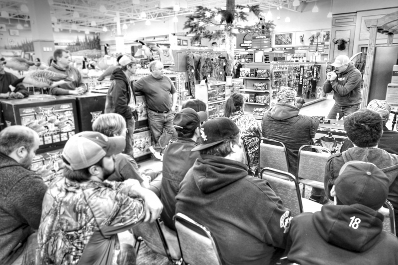Guide and professional caller Jay Kuypers teaching a how to seminar at Cabela's