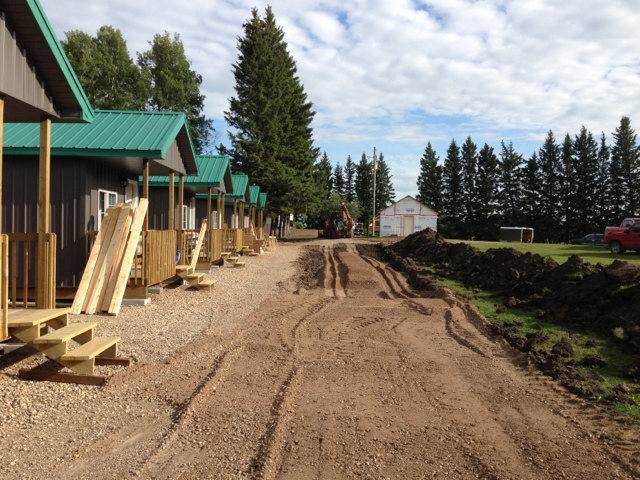 Building the road wider in front of the cabins... 5